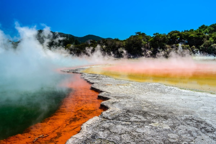 Champagne pool, a lake with red, orange, yellow, green and blue colors with smoke due to its warmth. Geothermal in New Zealand, in Way-o-Tapu