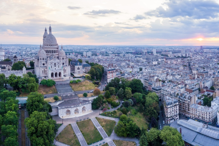 Discover nature in Paris from a drone, at sunrise. Louvre, Notre-Dame, Montmartre